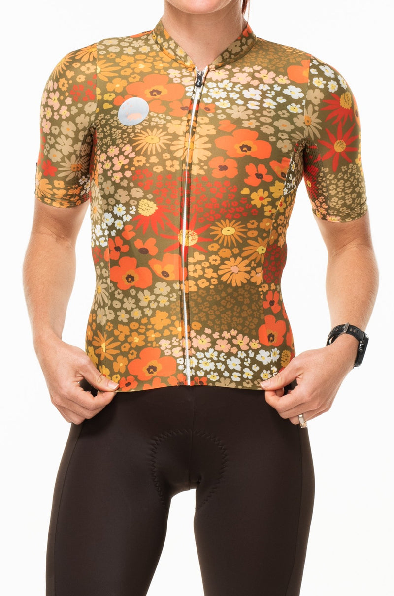 WYN republic retro women's cycling jersey - Ochre. Pink premium cycling jersey that has a wild flower print.