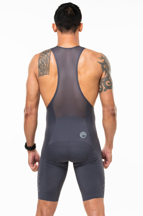 Back view of men's Velocity Cycling Bib Shorts. Aerodynamic slate cycling shorts. Bib shorts with mesh straps.