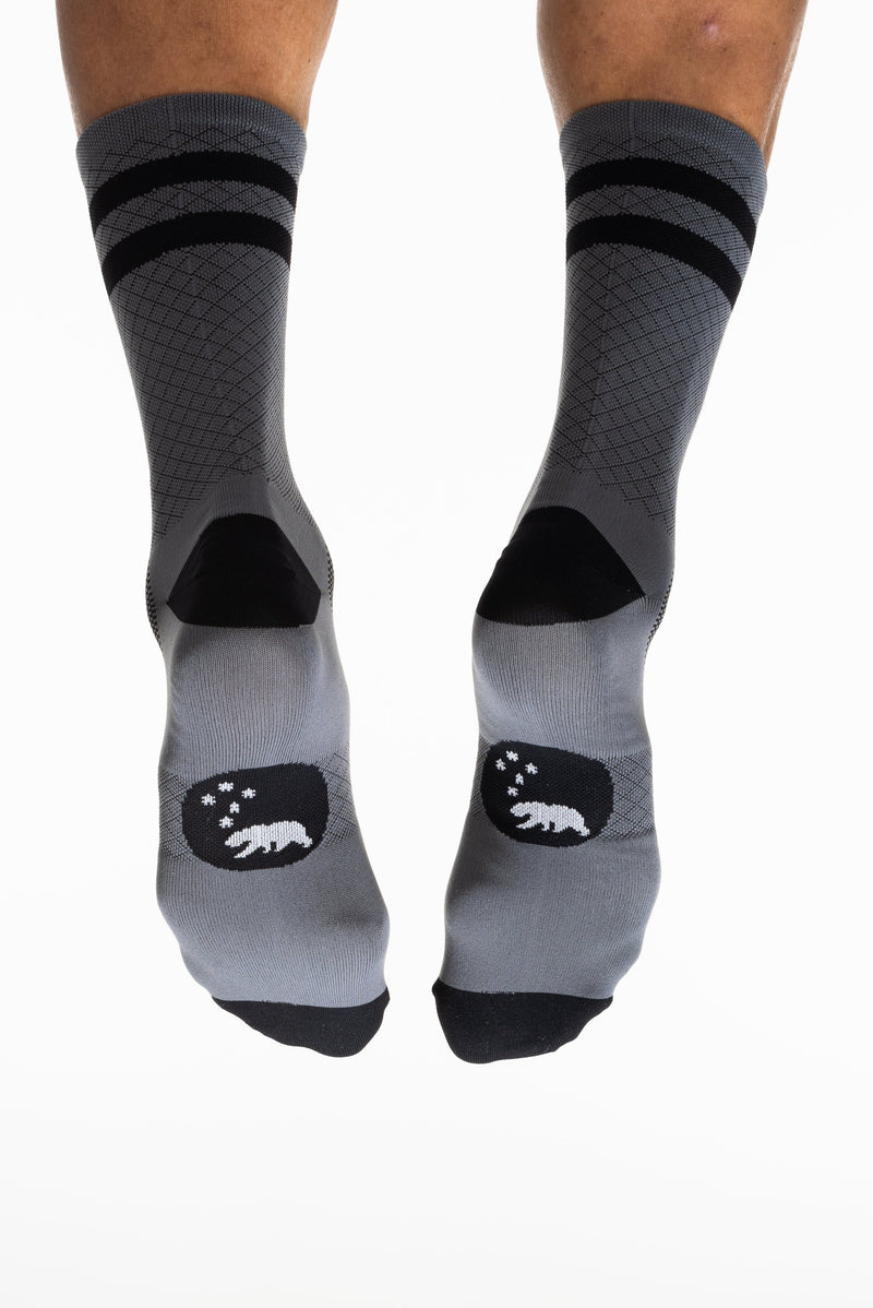 Back and bottom view of WYN Flagship Grey socks. Grey socks with black stripes on calf and bear logo on sole.