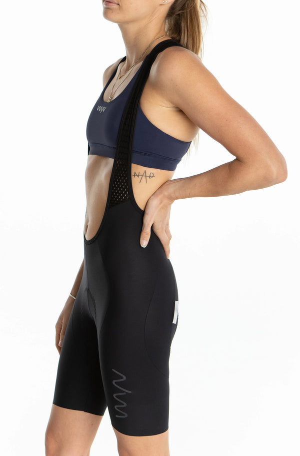 WYN republic women's Luceo Bib Shorts. Black cycling bib shorts with mesh straps and gloss logo.