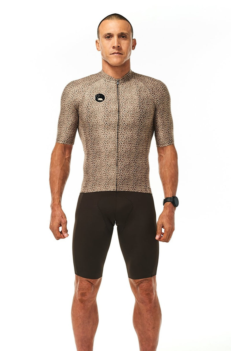 Model wearing Big Cat Pro Cycling Jersey 'Wild Cat' with brown bibs. Wild and fast cycling jersey.