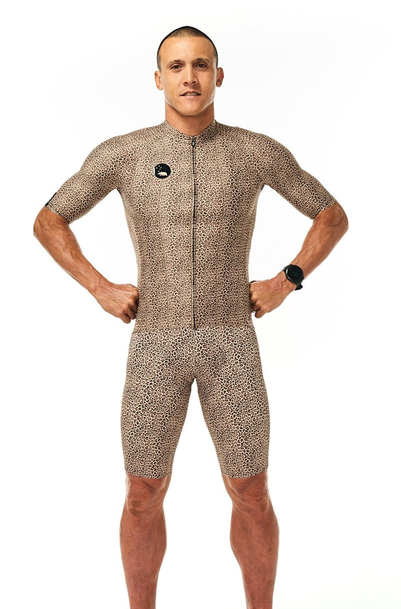 Model wearing men's Wild Cat Velocity Cycling Bib Shorts with matching jersey. Leopard print jersey.