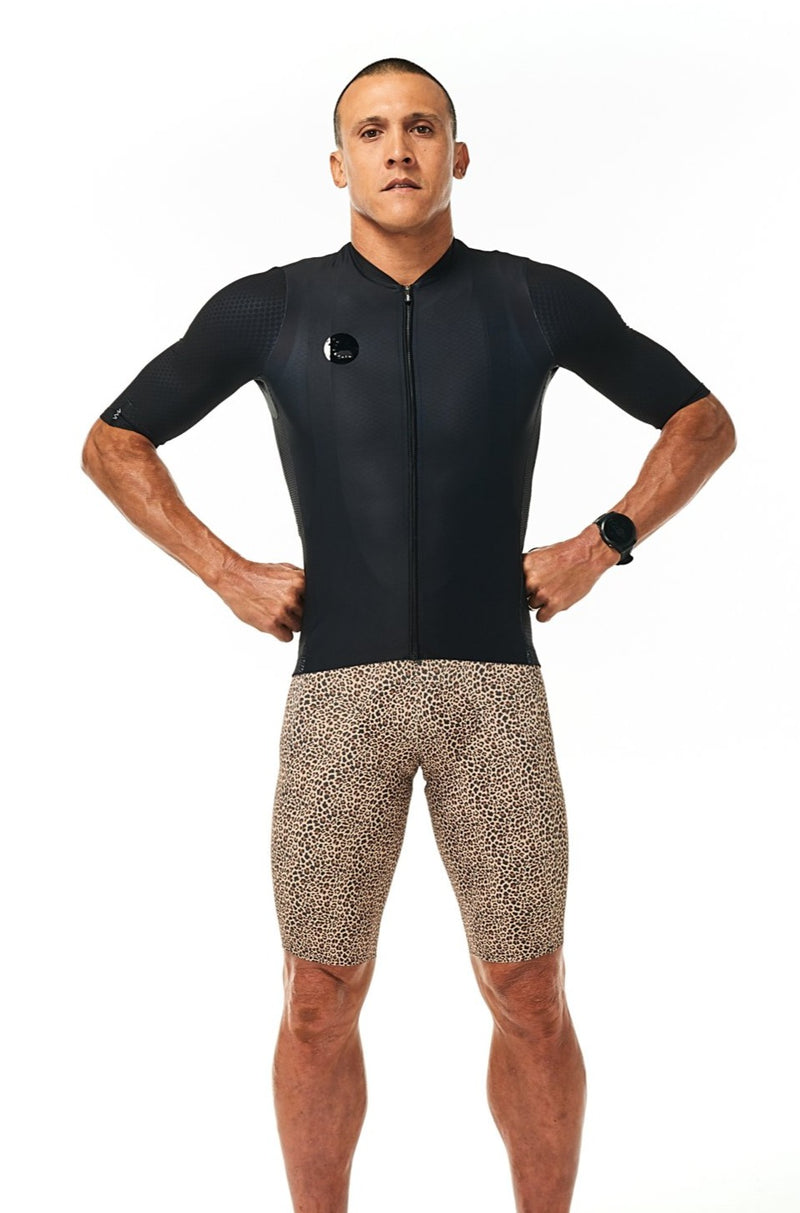 Model wearing men's Wild Cat Velocity Cycling Bib Shorts with black jersey. Stylish bib short.