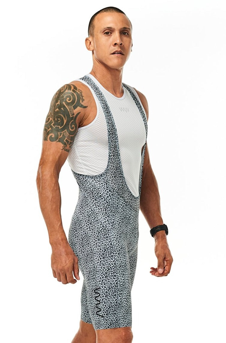 Right angle men's Snow Leopard Velocity Cycling Bib shorts. Animal print with black logo bib shorts.