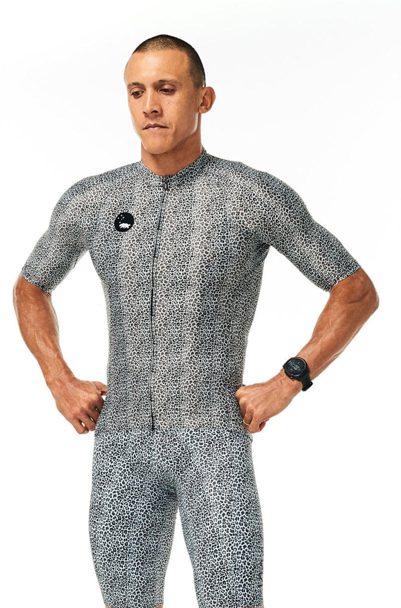 Model wearing men's Snow Leopard Velocity Cycling Bib Shorts and matching jersey. Stylish bib short.