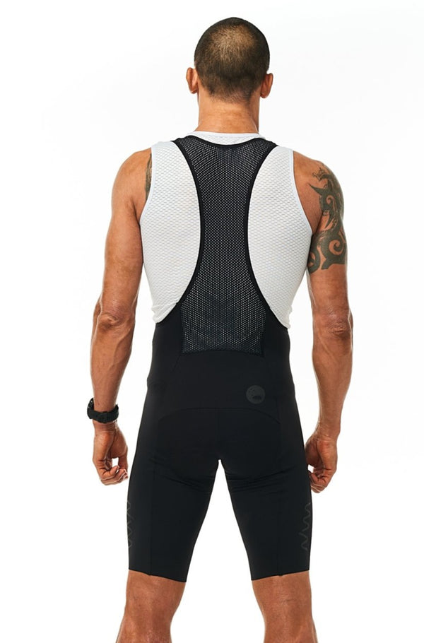 Back view of men's Velocity Cycling Bib Shorts. Aerodynamic black cycling shorts. Bib shorts with mesh straps.