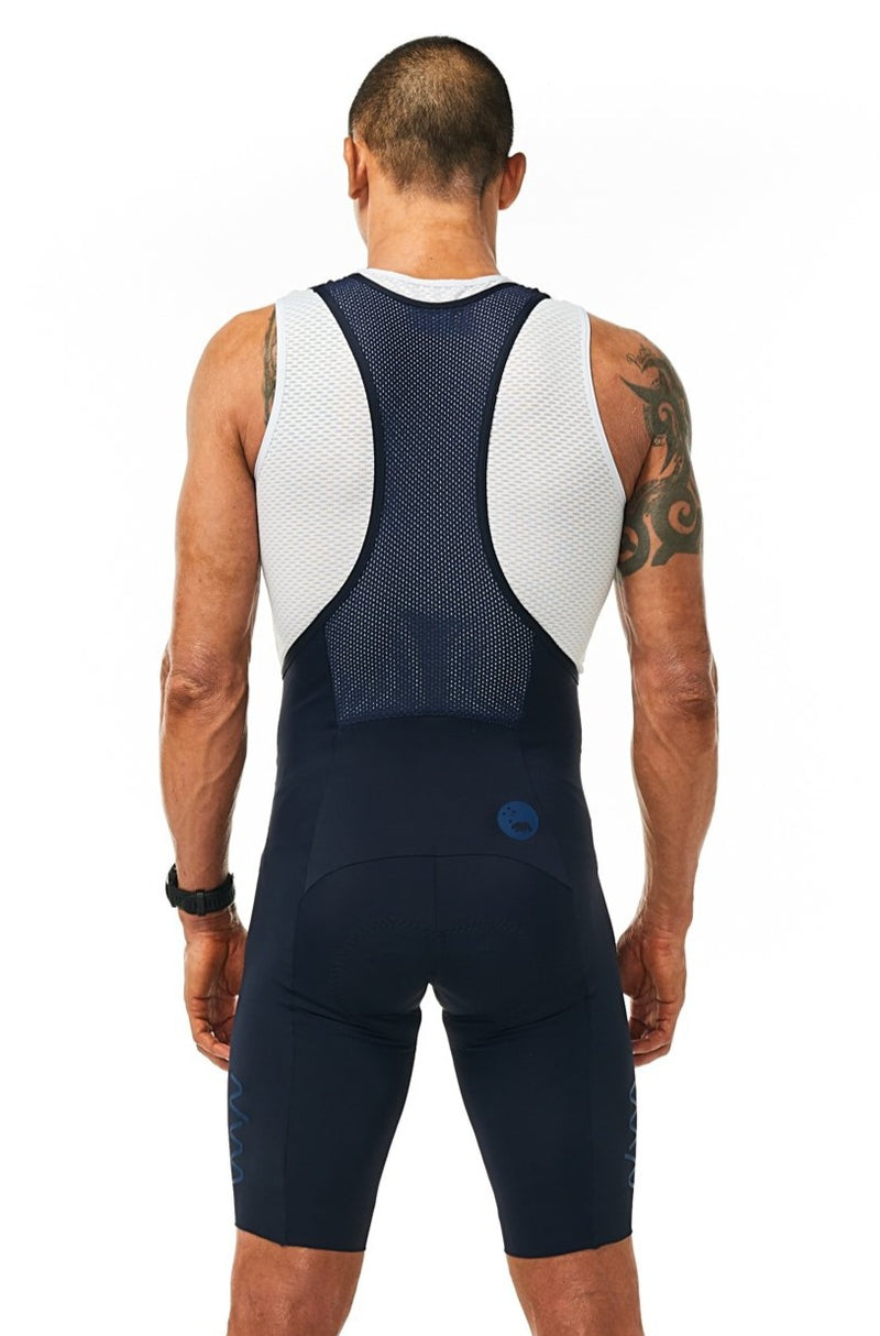Back view of men's Velocity Cycling Bib Shorts. Aerodynamic navy cycling shorts. Bib shorts with mesh straps.