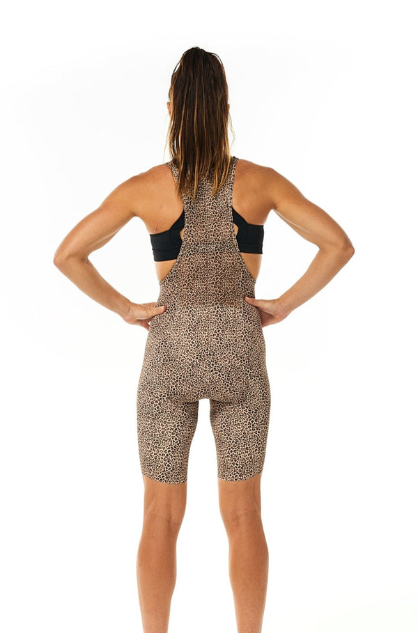 Back view women's Wild Cat Velocity Cycling Bib Shorts. Animal print cycling shorts with storage.