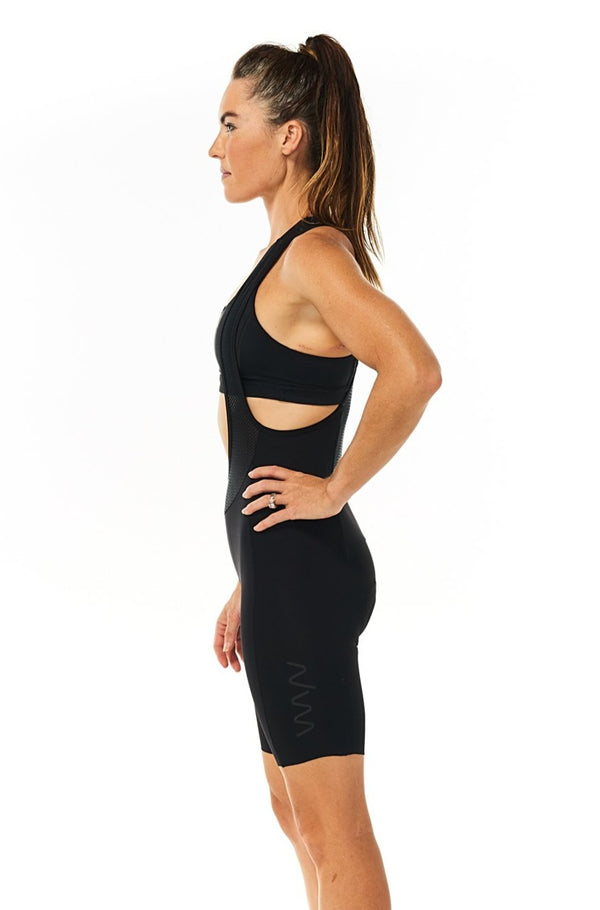 Left side of women's black Velocity Cycling Bib Shorts. No-cuff aerodynamic cycling shorts.