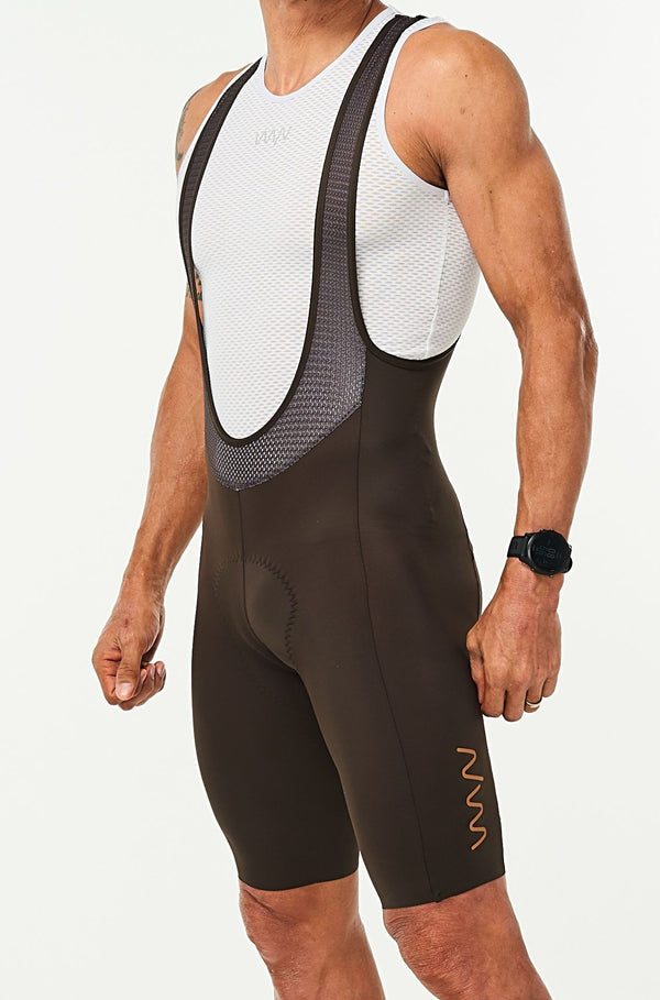 Men's Mocha Velocity Cycling Bib Shorts. Brown bib shorts with tan WYN republic logo on thigh.