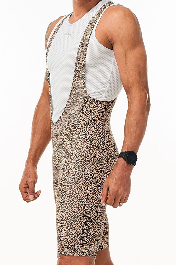 Left angle men's WYN republic Big Cat Velocity Cycling Bib Shorts 'Wild Cat.' Animal print shorts.
