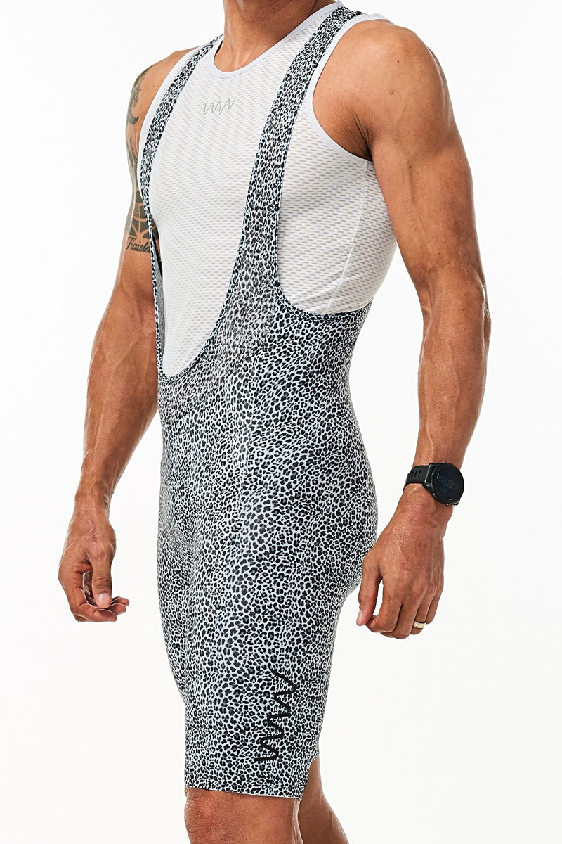 Left angle men's WYN republic Snow Leopard Big Cat Velocity Cycling Bib Shorts. Animal print shorts.