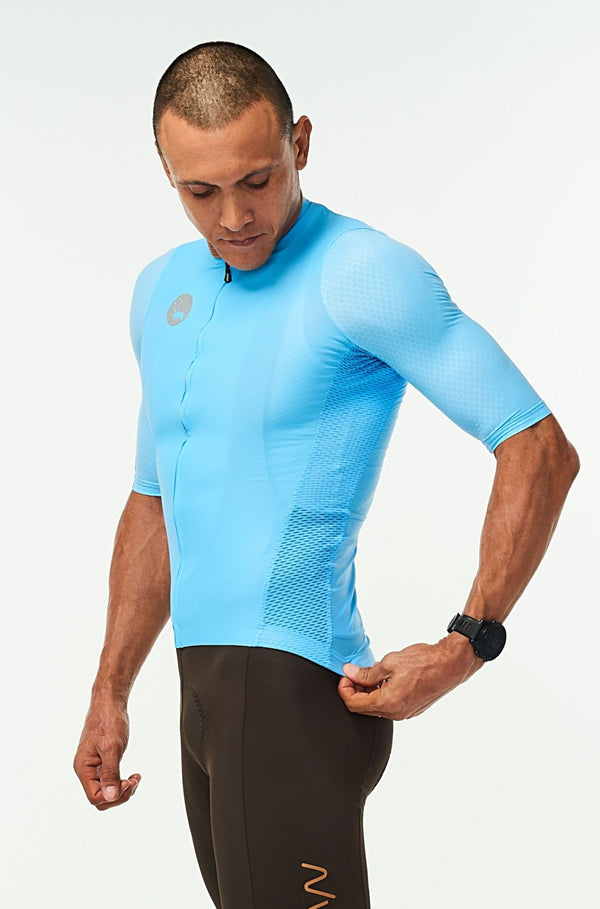 Left side of men's Hex Racer Jersey. Blue cycling jersey with mesh panels for ventilation.