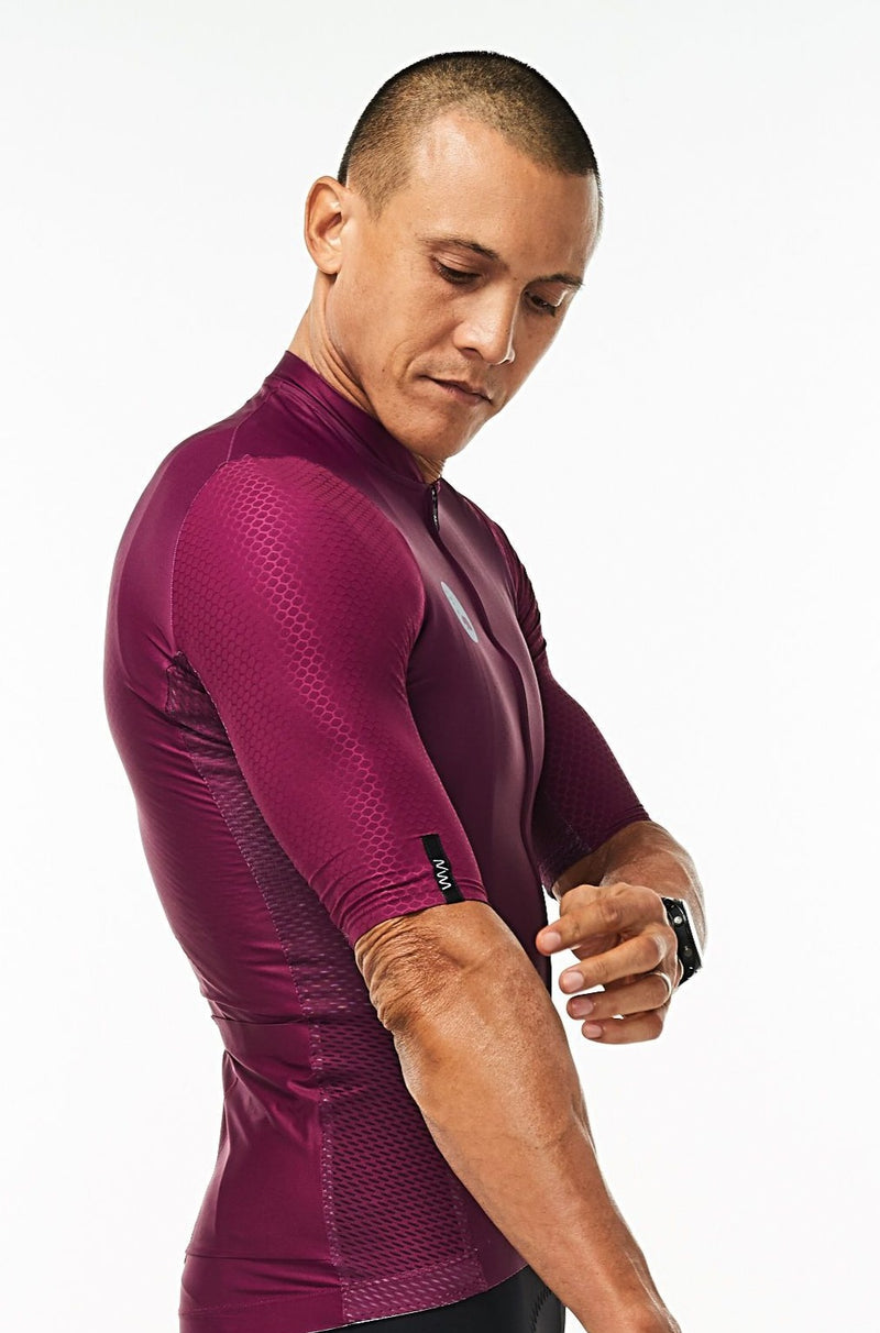 Right arm of men's Tyrian Hex Racer Jersey. Purple aerodynamic sleeves with Italian Hex fabric.
