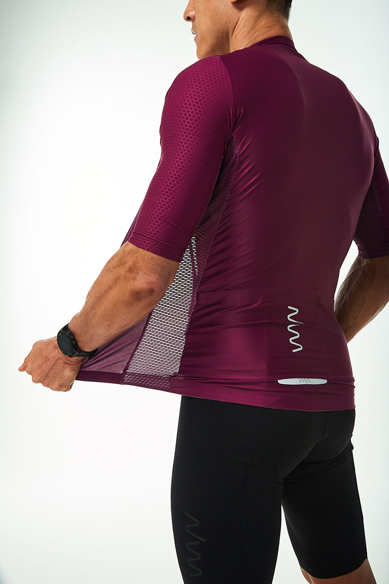 Back left angle of unzipped Tyrian Hex Racer Jersey. Breathable Italian fabric.