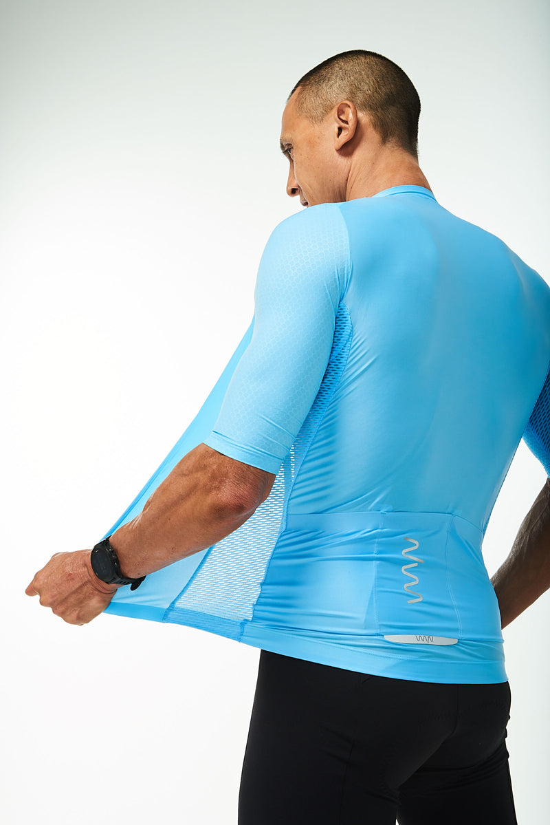 Back left angle of unzipped Sky Blue Hex Racer Jersey. Breathable Italian fabric.