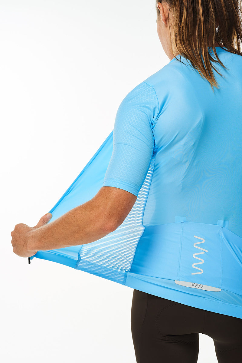 Back left angle of unzipped Sky Blue Hex Racer Jersey. Women's breathable cycling jersey with Italian fabric.