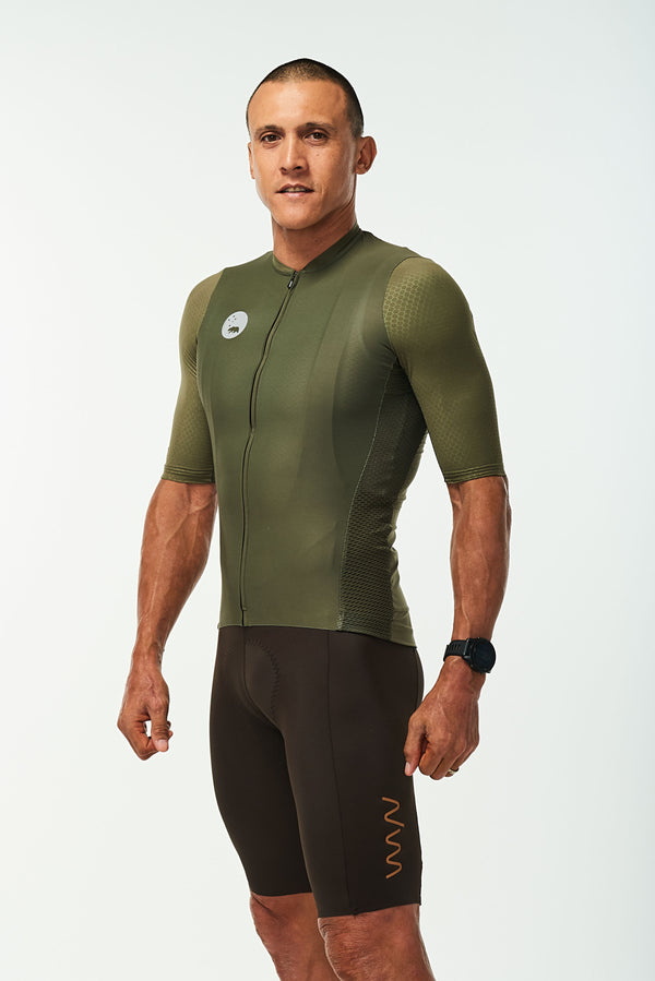 Left side of men's Hex Racer Jersey. Green cycling jersey with mesh panels for ventilation.