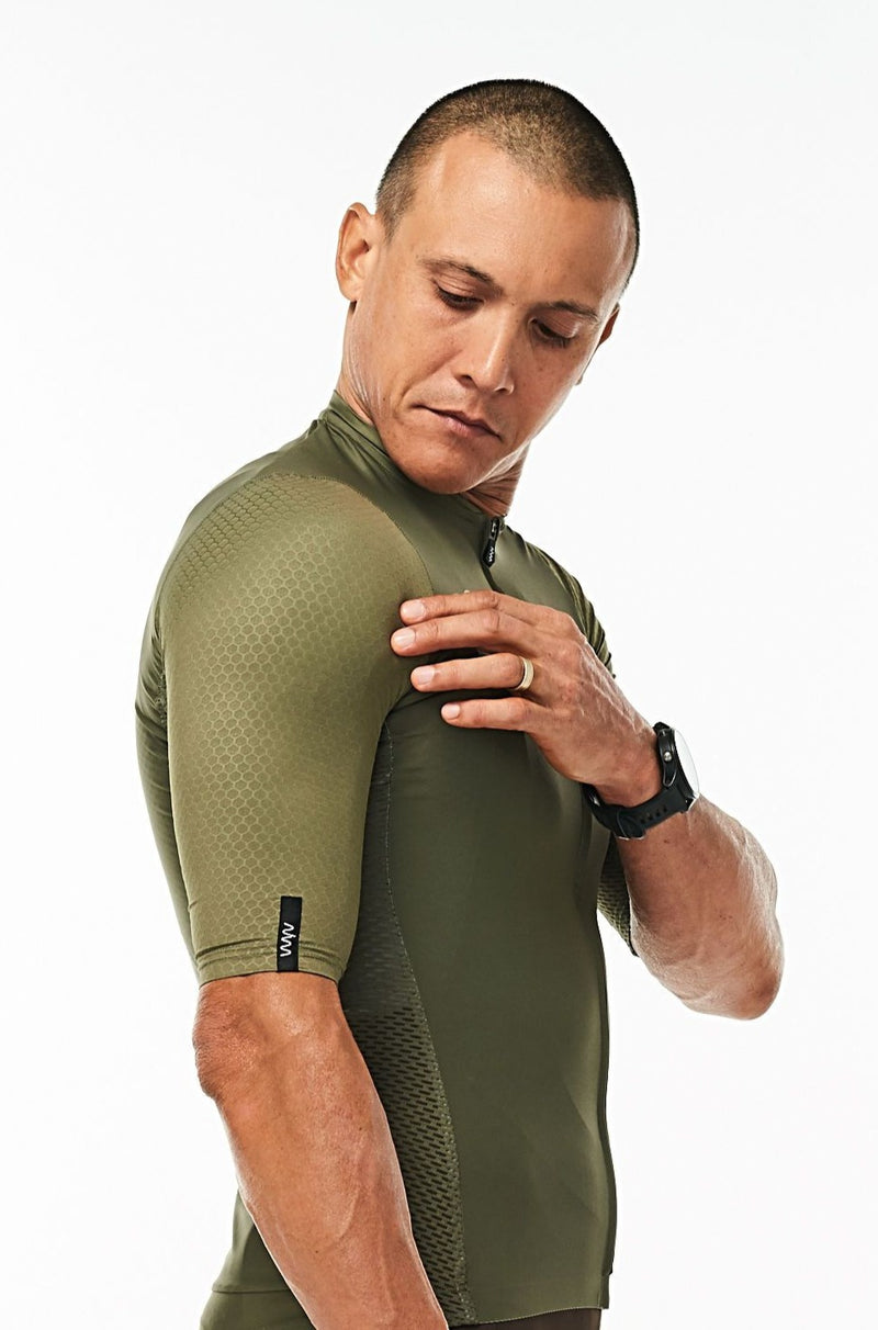 Right arm of men's Olive Hex Racer Jersey. Green aerodynamic sleeves with Italian Hex fabric.