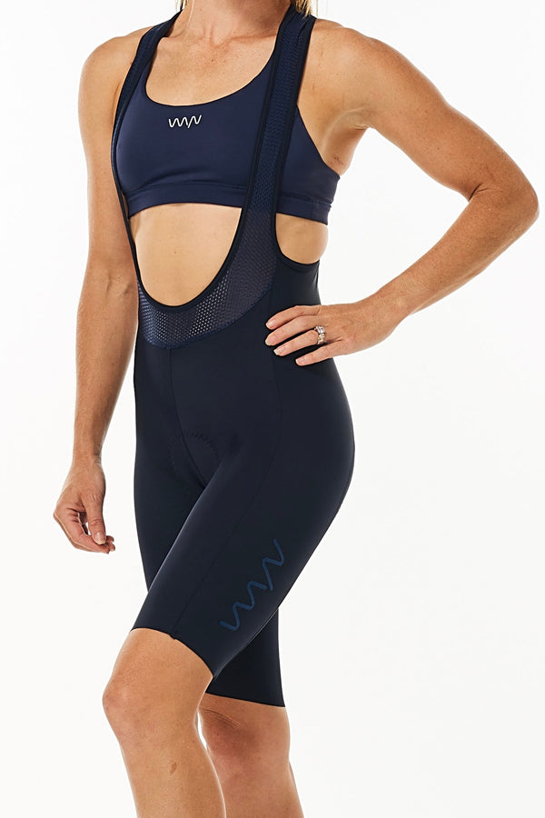 Women's Velocity Cycling Bib Shorts. Navy bib shorts with blue WYN republic logo on thigh.