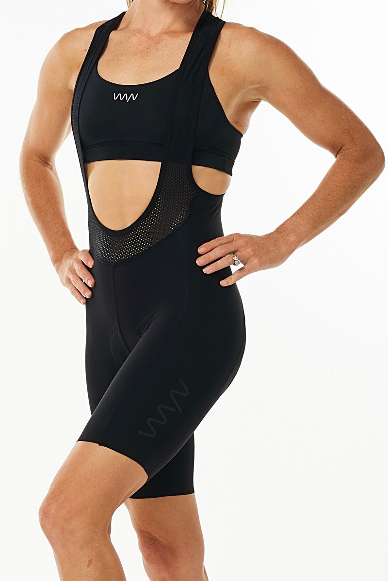 Women's Velocity Cycling Bib Shorts. Black bib shorts with black WYN republic logo on thigh.