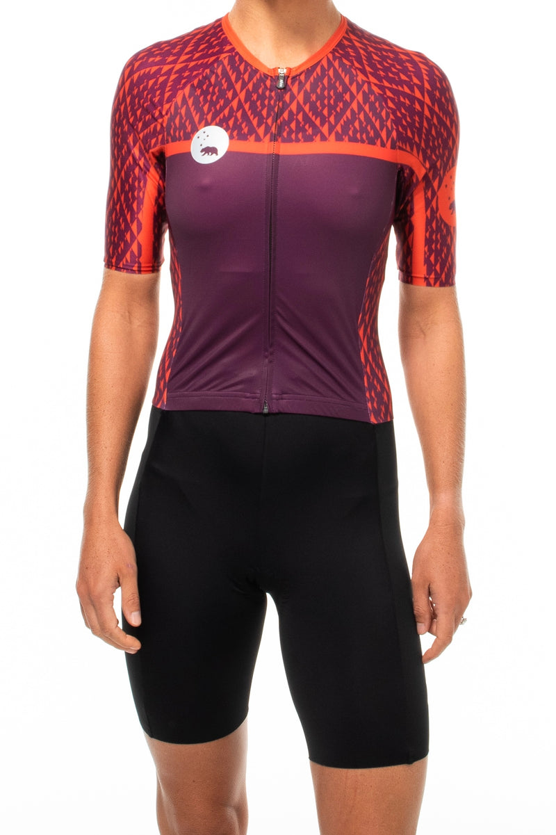 Women's WYN republic Rise tri suit. Red and purple one-peice triathlon suit.