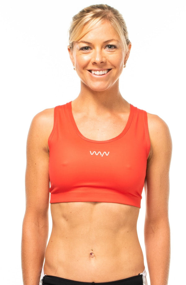 WYN republic Racergirl Racerback Bra - Poppy. Hot coral sports bra with light to moderate support and full coverage.