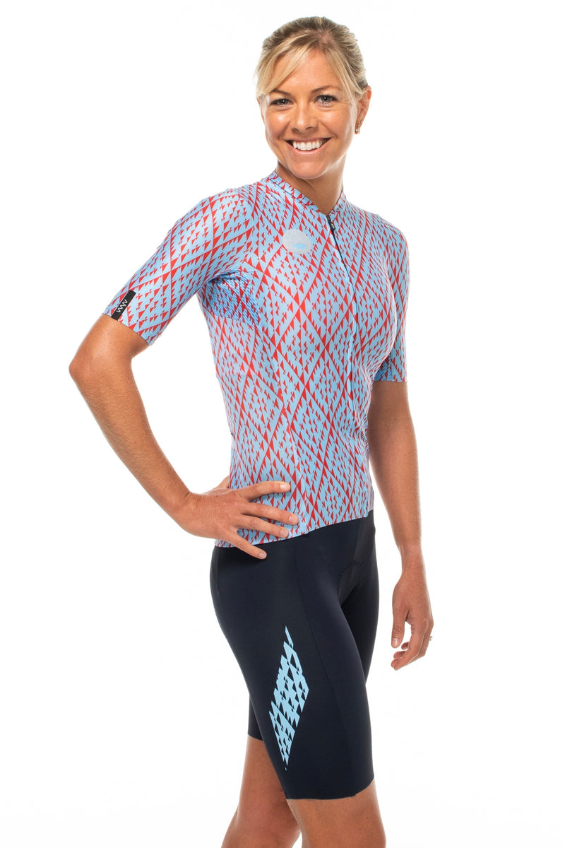 Model wearing Elevate bib shorts with matching Rise cycling jersey.