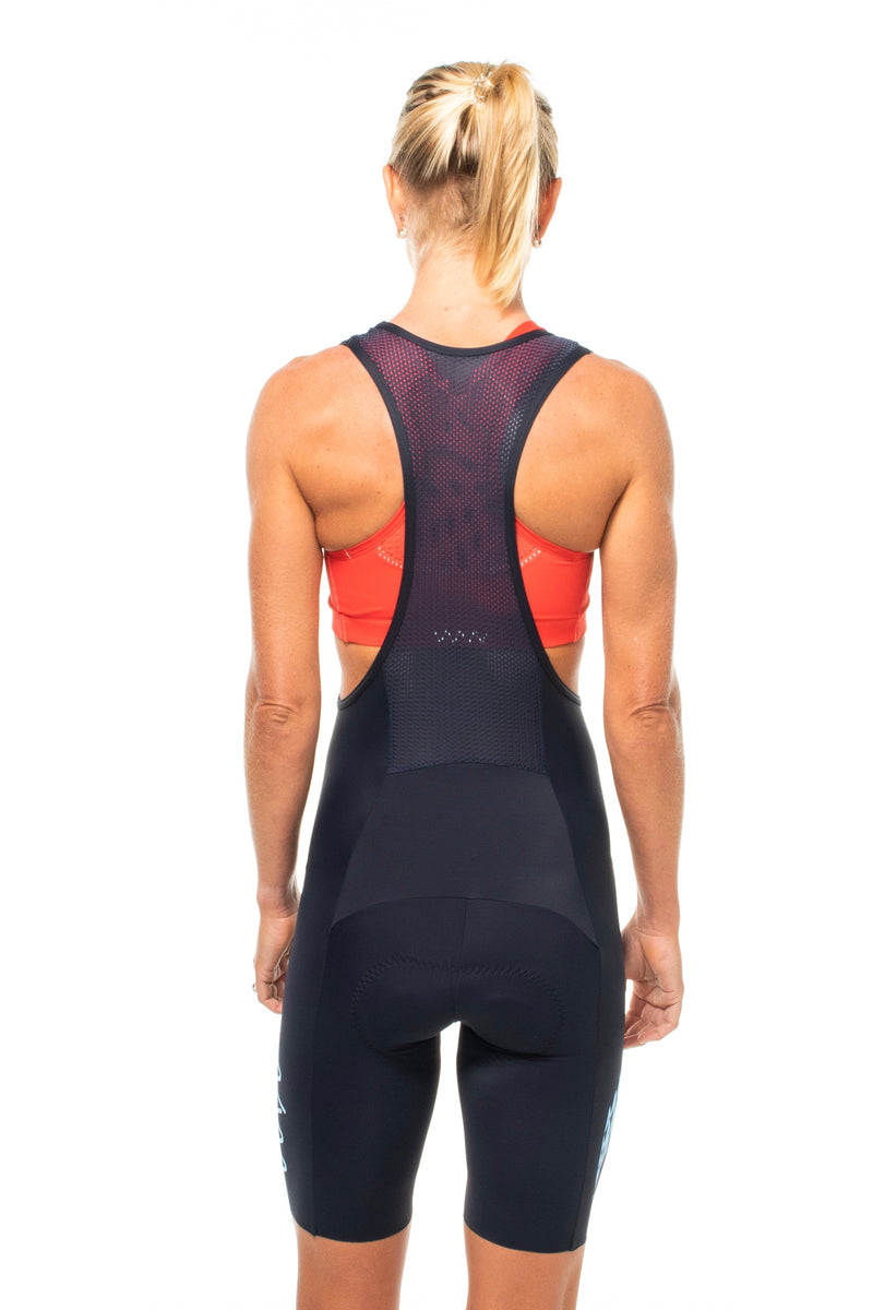 Back view women's Elevate  bib shorts. Mesh paneling and straps.