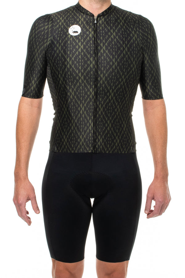 Men's Surge Pro Cycle Jersey. Black and green cycling jersey with diamond print.