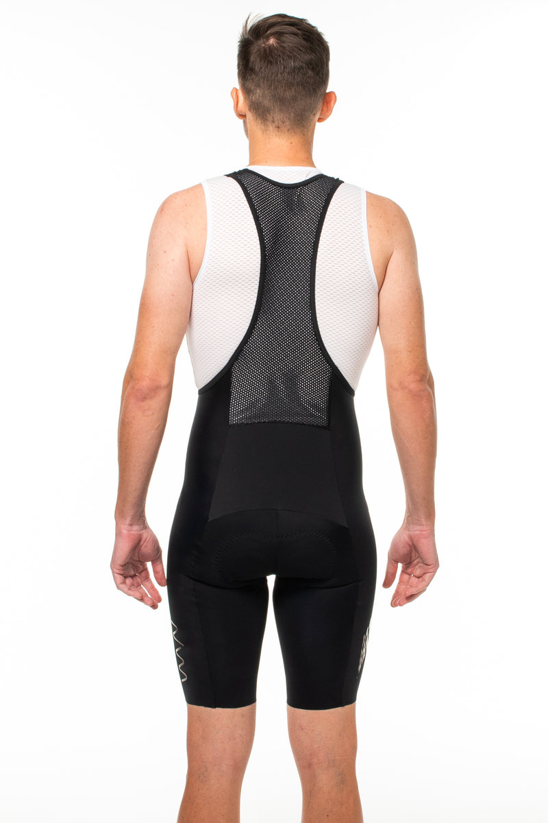 Back view men's Surge bib shorts. Mesh paneling and straps.
