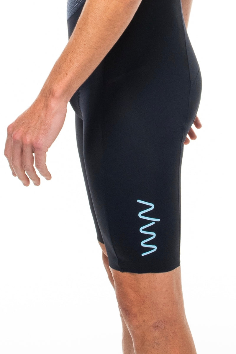 Close view right thigh of Shift bib shorts. WYN logo on thigh.