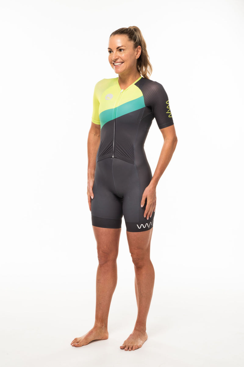 Left side women's Australiano tri suit. Reflective WYN logo on leg cuff and yellow logo left sleeve.