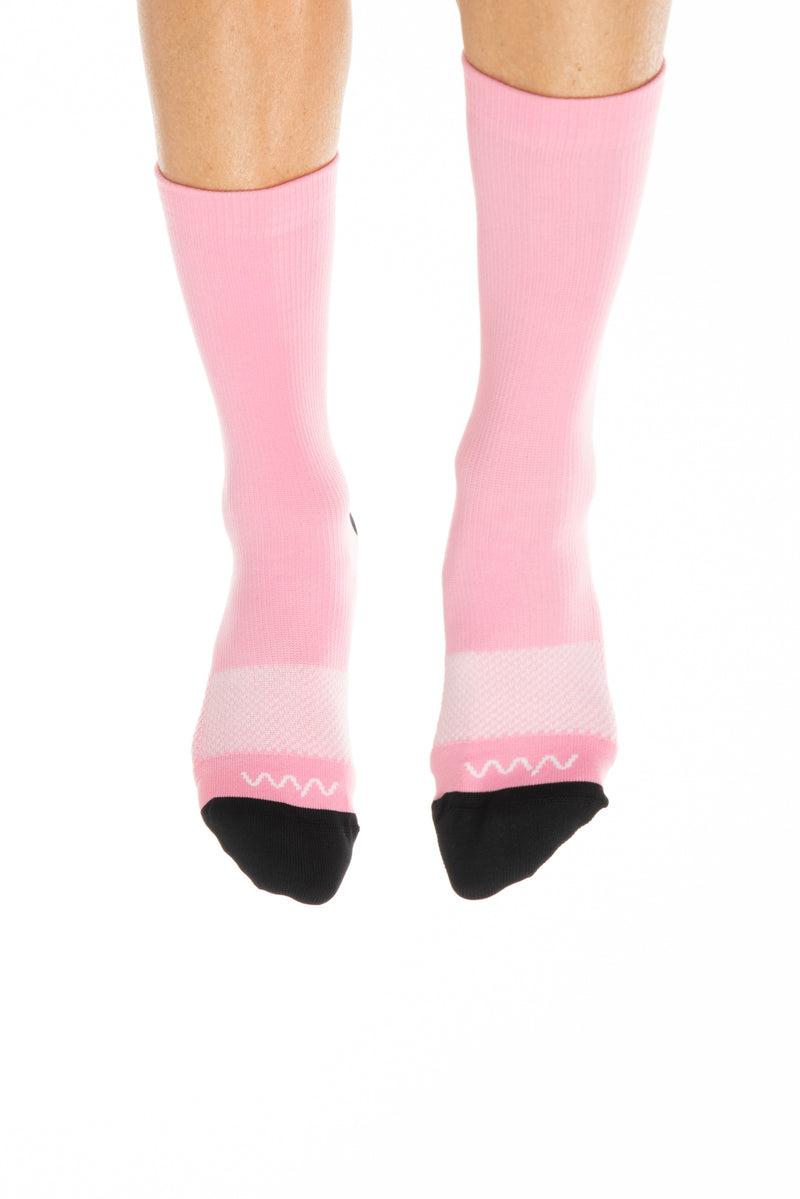 Front of women's Bandwidth Socks. Pink cycling socks with black toe box & light pink logo & stripe.