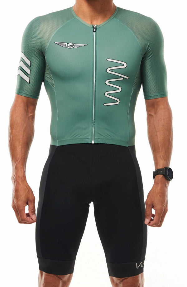 WYN republic Freedom Fighter tri suit. Green sleeved triathlon suit with black shorts.