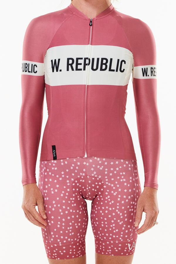 Women's WYN republic Joni Summer Long Sleeve Cycling Jersey. Pink cycling jersey with white stripe.