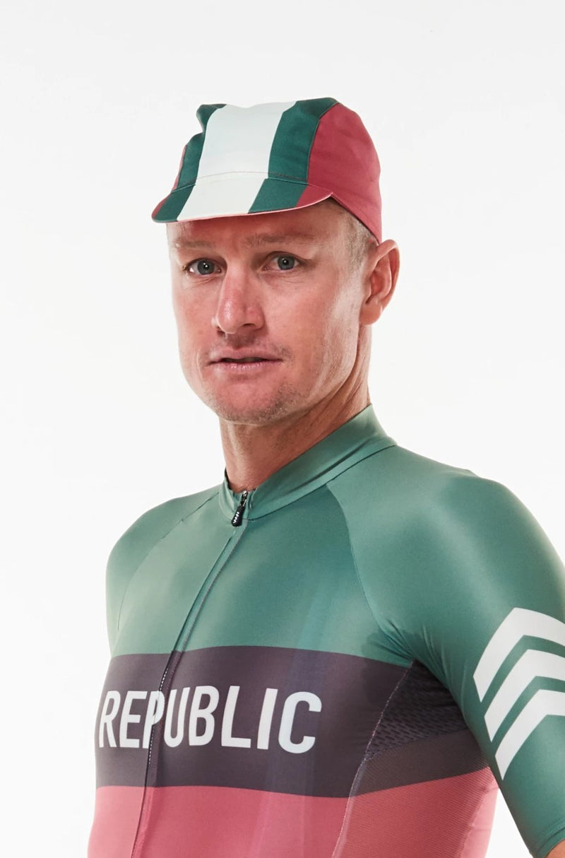 Model wearing Alliance cycling cap. Green and white strip center with red sides cycling hat.