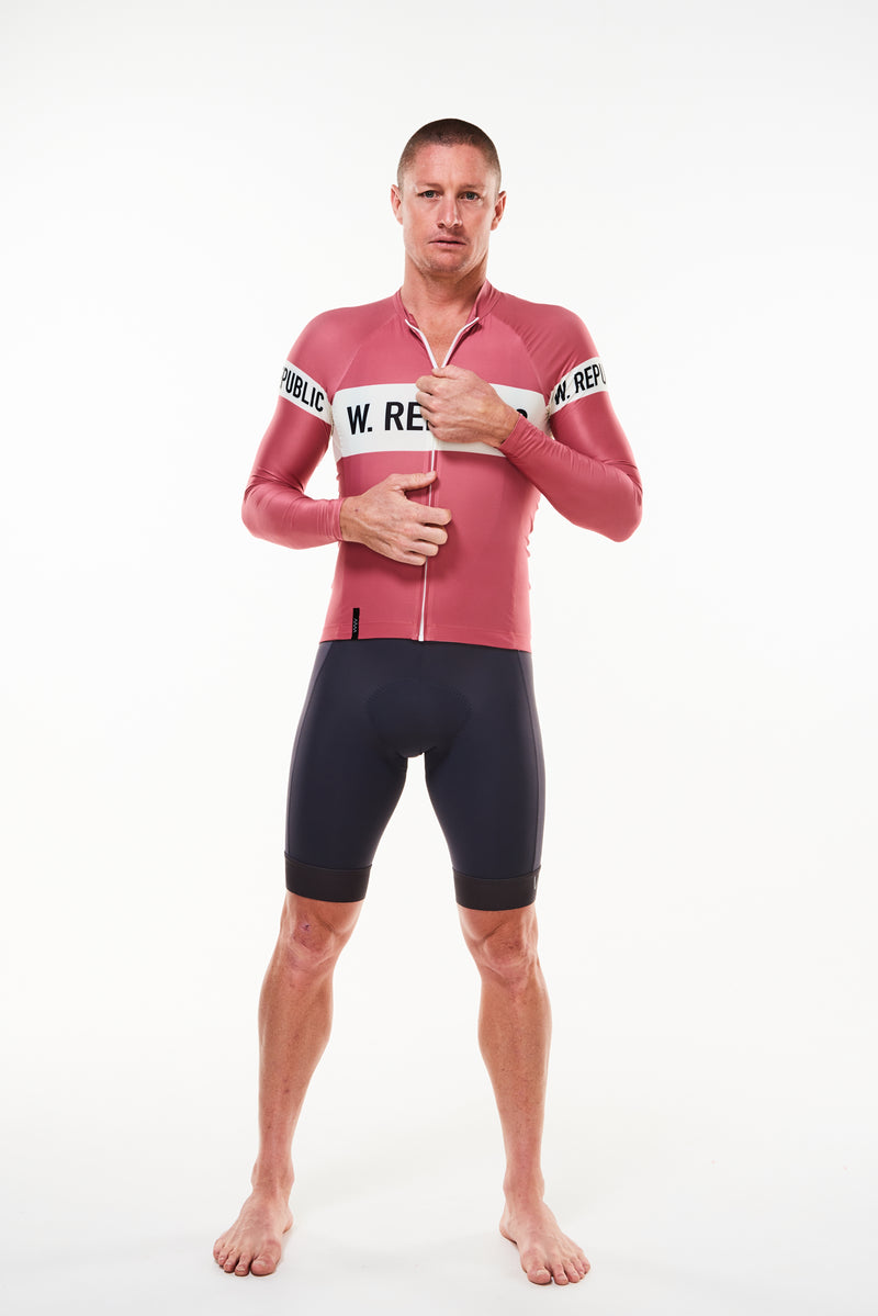 Model zipping Code Red Summer Long Sleeve Cycling Jersey. Cycling jersey with flip-lock zipper.