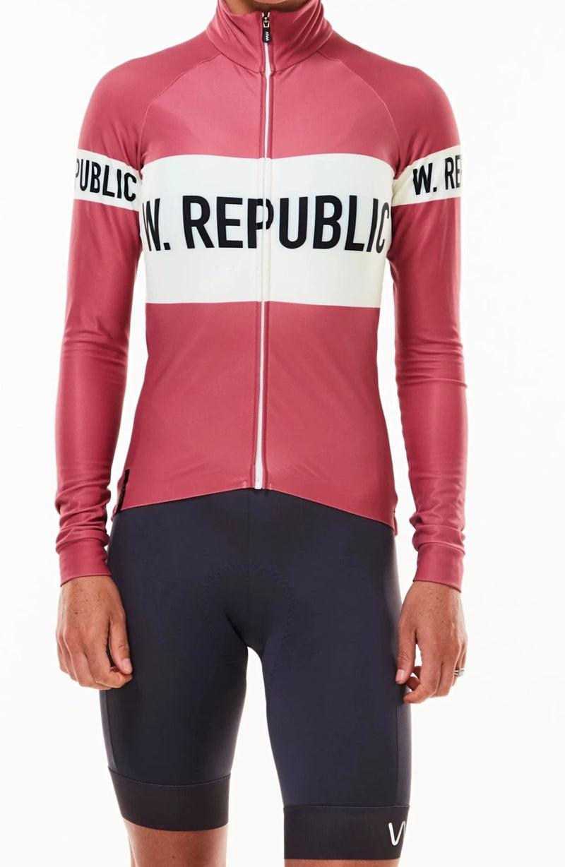Women's WYN republic Joni thermal cycling jacket. Pink with white stripe and logo across chest.
