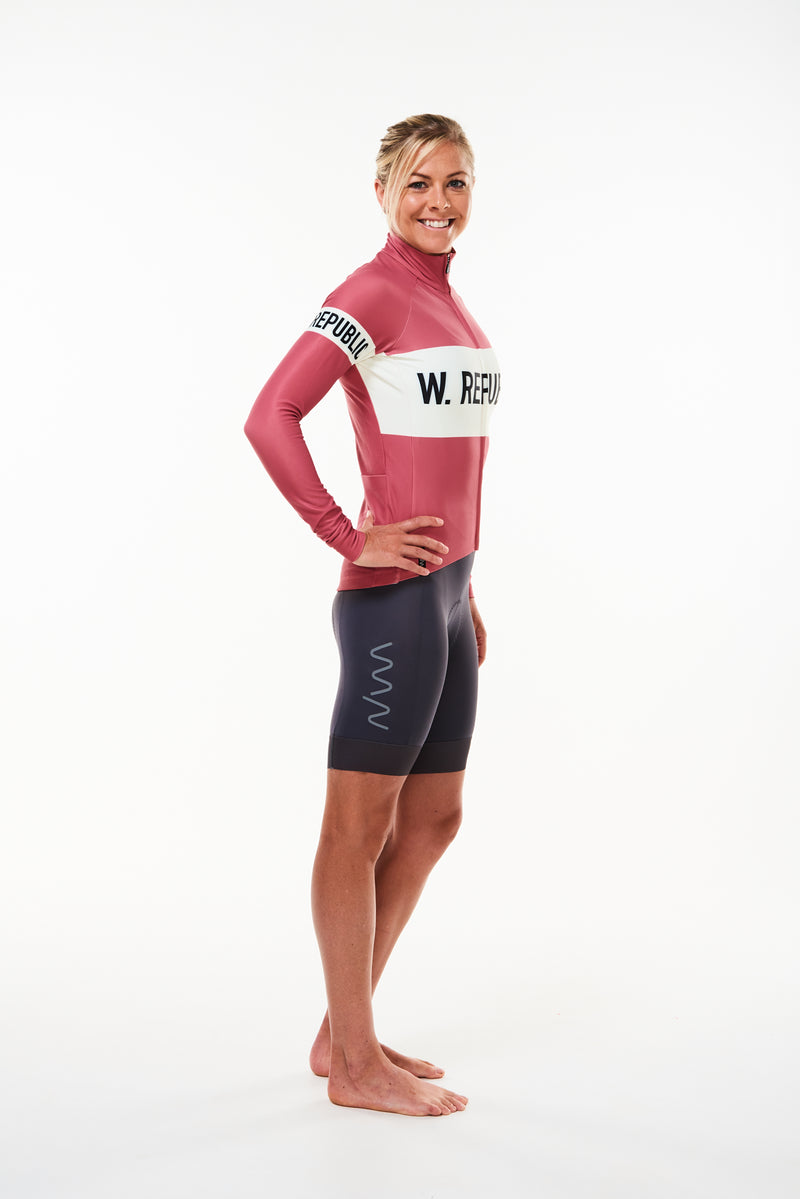 Model showing right side women's Joni thermal cycling jacket. Long sleeve thermal cycling jersey.