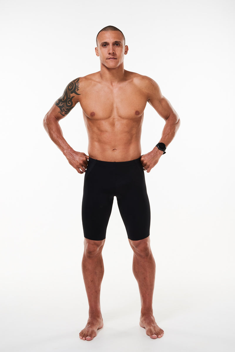 Model wearing men's WYN republic Velocity Tri Shorts. Front view of quick-drying triathlon shorts.