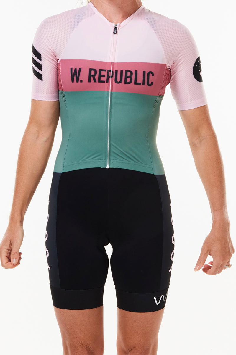 Women's WYN republic Rebel tri suit. Pink and green one-piece sleeved tri suit with black shorts