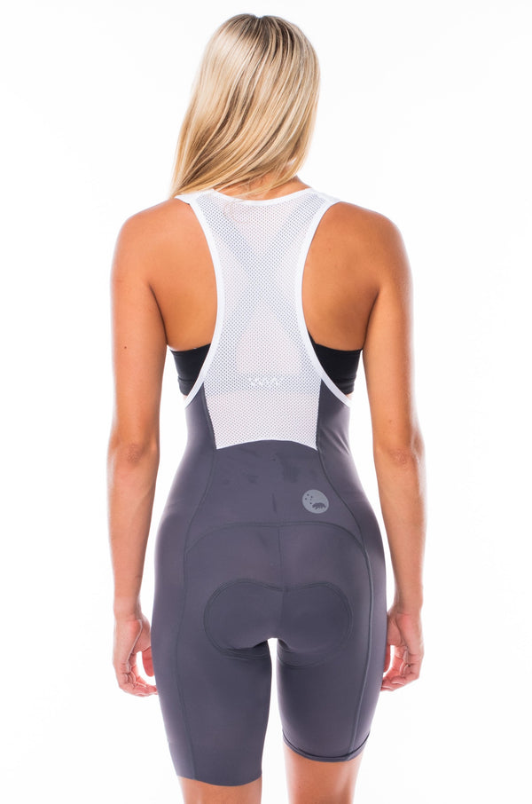Back view of women's Velocity 2.0 Cycling Bib Shorts. Aerodynamic slate cycling shorts with white mesh back panel.