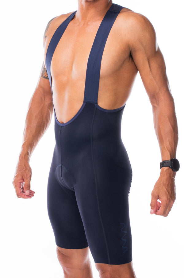 Men's Velocity 2.0 Cycling Bib Shorts. Navy bib shorts with blue WYN republic logo on thigh.