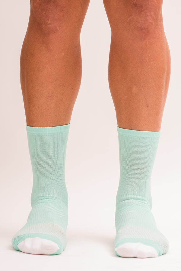 Front view men's Mint/Navy Socks. Swea-wicking mid-calf running and cycling socks.
