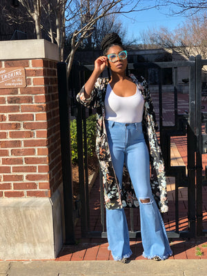 Light denim distressed bell bottoms