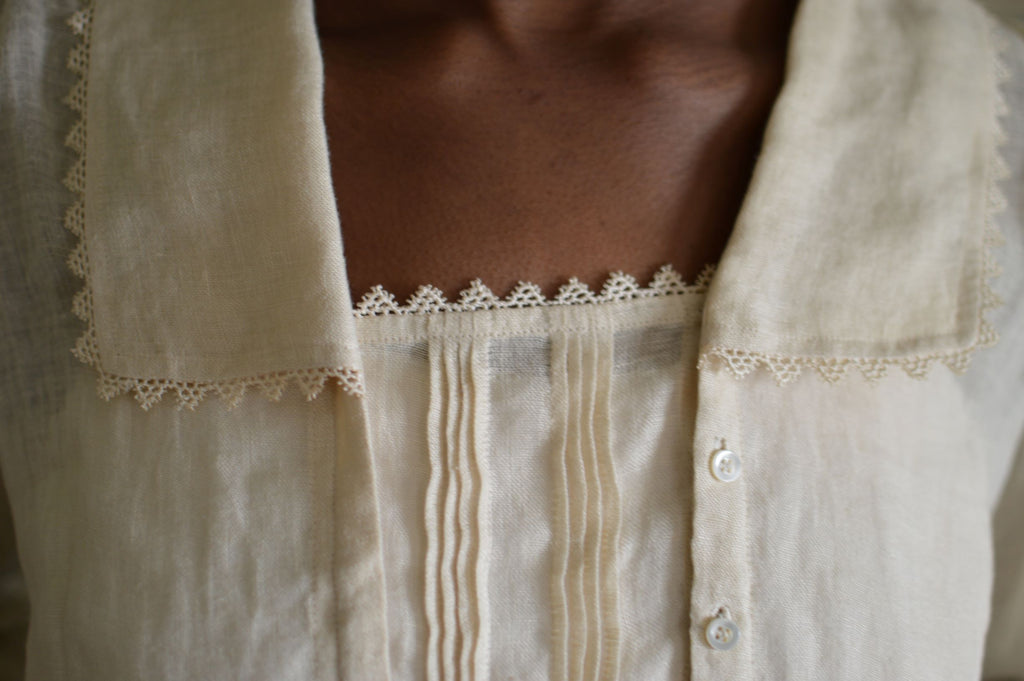 close up of woman in cream colored armistice blouse