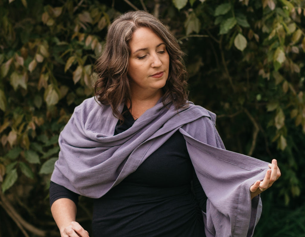 Woman outdoors wearing 271 Sunset Wrap.  Garment is made in a grey double gauze fabric.