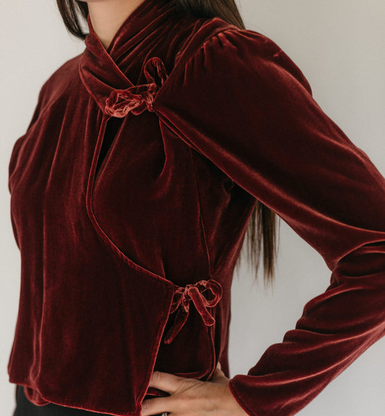 Dark red velvet wrap blouse, close up of front.