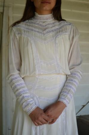 Close up of a white laced Edwardian Dress